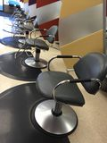 Hair salon chairs. A hair salon chair for clients clientele in a Stock Images