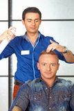 Hair salon. Man haircut. Spraying. Royalty Free Stock Photography