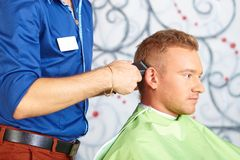 Hair salon. Men`s haircut. Cutting. Stock Images