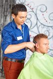 Hair salon. Men`s haircut. Cutting. Royalty Free Stock Image