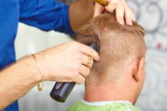 Hair salon. Men`s haircut. Cutting. Royalty Free Stock Photo