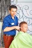 Hair salon. Men`s haircut. Cutting. Royalty Free Stock Photography