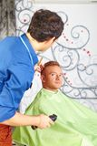 Hair salon. Men`s haircut. Cutting. Stock Photography