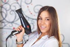 Hair salon. Portrait of hairdresser. Stock Photos