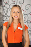 Hair salon. Portrait of young woman with badge. Royalty Free Stock Images