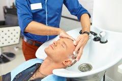 Hair salon. Washing with shampoo. Stock Photo