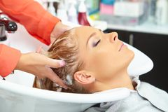 Hair salon. Washing with shampoo. Royalty Free Stock Photos