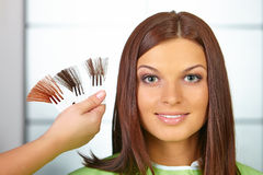 Hair salon. Woman choses color of dye. Stock Image