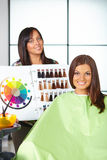 Hair salon. Woman choses color of dye. Stock Images