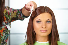 Hair salon. Woman choses color of dye. Royalty Free Stock Photos