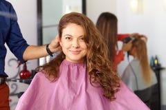 Hair salon. Woman haircut. Combing. Royalty Free Stock Photos