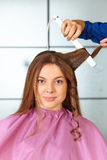 Hair salon. Woman haircut. Use of straightener. Royalty Free Stock Image