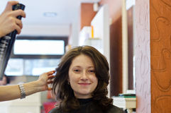 Hair salon. Woman tries new hairstyle in hair salon royalty free stock photos