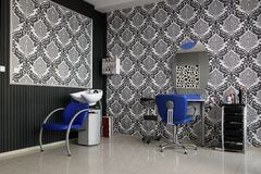 Hair saloon. Modern empty hair saloon with chairs and mirrors Stock Photos