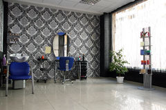 Hair saloon. Modern empty hair saloon with chairs and mirrors Royalty Free Stock Images