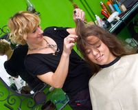 Hair and scalp massager. Woman enjoying hair and scalp massage in salon Stock Images