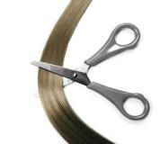Hair and scissors. Closeup of long human hair and scissors Stock Photos