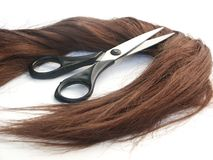 Hair and scissors. Brown direct hair and scissors Stock Photo