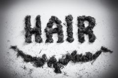 Hair sign made from real hair. Hairdressers hair sign made from facial beard clippings in an old style retro fashion Stock Images