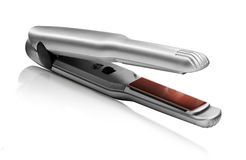 Hair straightener isolated Royalty Free Stock Photos