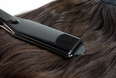 Hair straighteners and hair Royalty Free Stock Photo