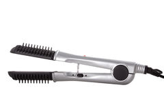 Hair straighteners. Isolated over white Royalty Free Stock Photo