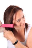 Hair Straightening Stock Photo