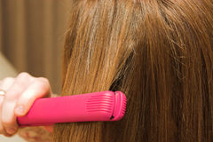 Hair straightening Stock Images