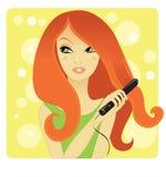 Hair straightening. Pretty redhead girl straightening her hair Stock Photo