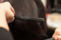 Hair Straightening Closeup Shot Stock Images