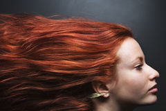 Hair streaming behind woman. Pretty redhead young woman profile with hair streaming out behind her royalty free stock photos