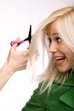 Hair stress. Young blond woman at hairdresser afraid of cutting her hair Royalty Free Stock Images