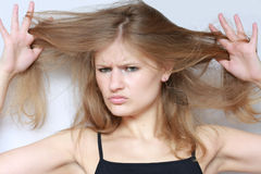 Hair style. Young woman with sad expression. hair style Stock Photography