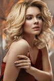 Hair Style. Beautiful Woman With Fashion Volume Haircut. Female With Curly Blonde Hair. High Resolution royalty free stock images