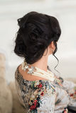 Hair style, dress. Elegant, dark brunette. Luxury Stock Photos
