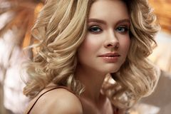 Hair Style And Makeup. Beautiful Blonde Woman With Volume Hair. Female Hairstyle And Beauty Make-Up. High Resolution stock photo