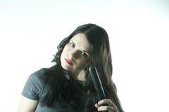 Hair styling. Long hair woman using hair styler Royalty Free Stock Photo