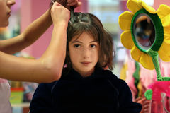 Hair styling party. A girl getting her hair done Royalty Free Stock Photo