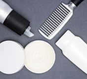 Hair styling products with a comb Royalty Free Stock Photos