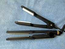 Hair Styling Set. Hair styling iron for both curling and straightening, and a styling iron for volumizing the roots Royalty Free Stock Photography
