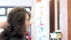 Hair styling. Young woman at hairdresser salon - hair styling concept stock footage