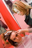 Hair-stylist. Woman's hair being painted at the hair stylist Stock Photo
