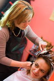 Hair-stylist. Woman's hair being painted at the hair stylist Royalty Free Stock Photo