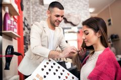 Free Hair Stylist And Customer At Cosmetics Salon, Doing A New Hair S Royalty Free Stock Images - 116104019