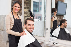 Hair stylist and client smiling at camera Royalty Free Stock Photos