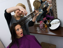 Hair stylist cuting woman hair Royalty Free Stock Photos