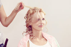 Hair stylist designer making hairstyle for woman Stock Image
