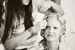 Hair stylist designer making hairstyle for woman. Bride in wedding day black and white tone Stock Photo