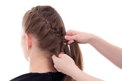 Hair stylist doing plait to young woman isolated on white Stock Image