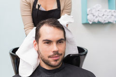 Hair stylist drying mans hair Royalty Free Stock Photography